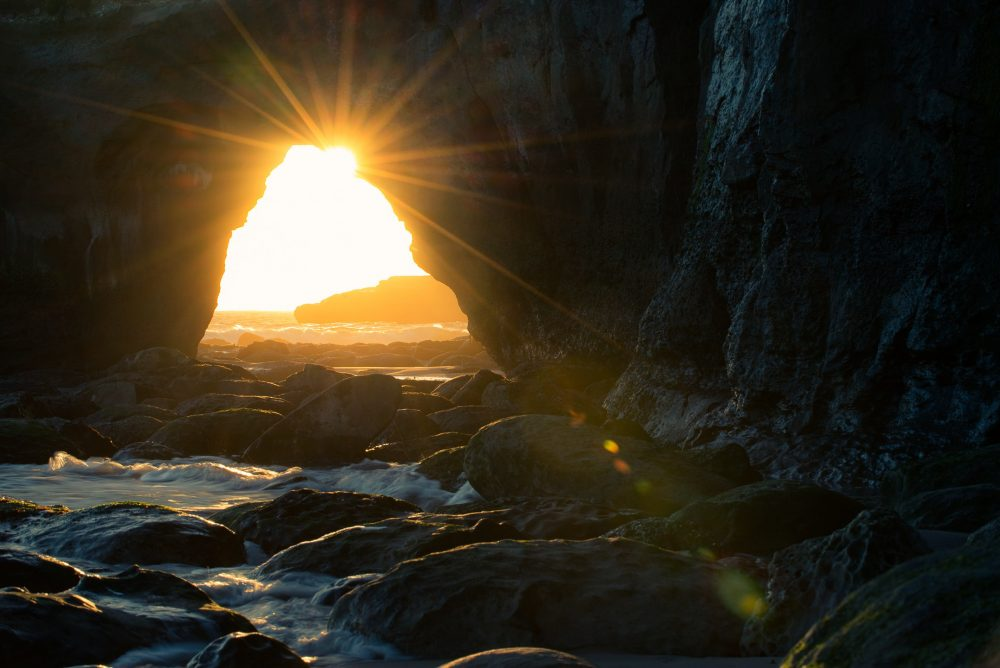 backlit-beach-cave-931910