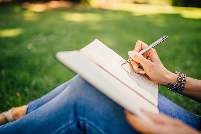 hand-notebook-outdoors-34072