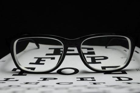 93734955-eyeglasses-on-eye-chart