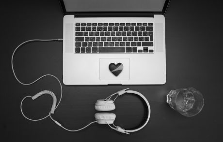 97565587-laptop-keyboard-what-headphones-wooden-back-1