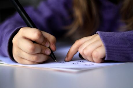 A-kid-drawing-or-writing