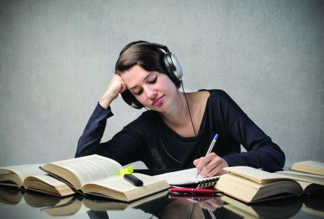 81372991SS-Female-student-listening-to-headphones