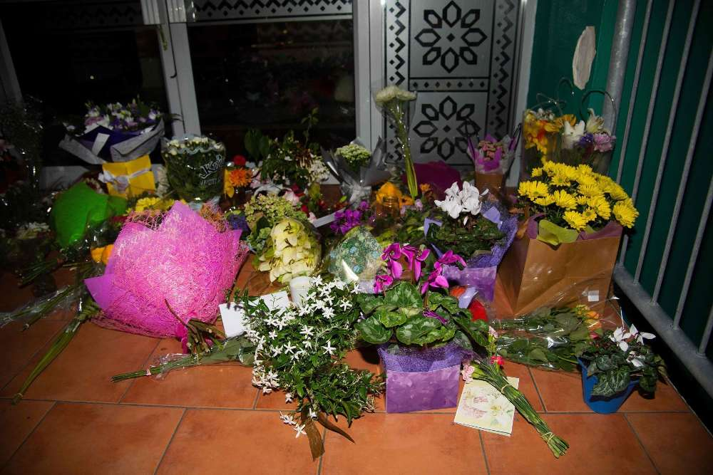 Flowers are placed on the front steps of the Wellington Masjid mosque in Kilbirnie in Wellington on March 15, 2019, after a shooting incident at two mosques in Christchurch. - Attacks on two Christchurch mosques left at least 49 dead on March 15, with one gunman -- identified as an Australian extremist -- apparently livestreaming the assault that triggered the lockdown of the New Zealand city. (Photo by Marty MELVILLE / AFP) NZEALAND-CRIME-SHOOTING